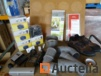 Various (shoes, elbows, trampoline tarpaulin for tipper,..) in a large plastic bin